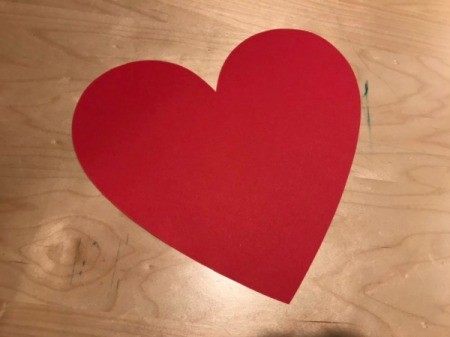 Arrow Toss Valentine's Day Toddler Game - red construction paper heart