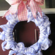 No Sew No Glue Ribbon Wreath - finished wreath hanging on a door by the ribbon bow loop hanger