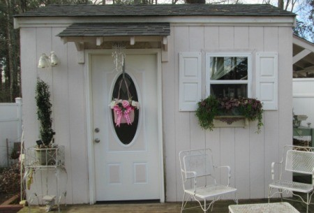 Straw Handbag Planter - attractive garden shed with purse planter hanging on the door