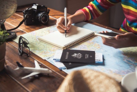 Making a list while planning a trip.