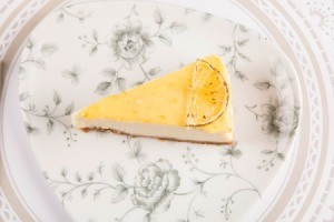 A slice of lemonade pie on a plate.