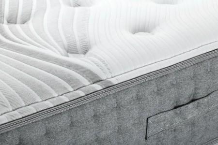 A bare bed mattress.