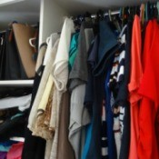 A crowded clothes closet.