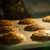 A tray of muffins baking in the oven.