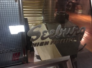 Value of a Seeburg 100 Selectomatic Jukebox - name on the glass/vinyl front