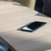 A cell phone sitting on a table or countertop.