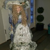 Identifying a Porcelain Doll - large doll with long blond curls and vintage clothing