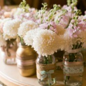 Simple flowers in jars for a wedding.