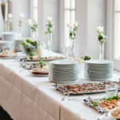 A table of catered wedding food.