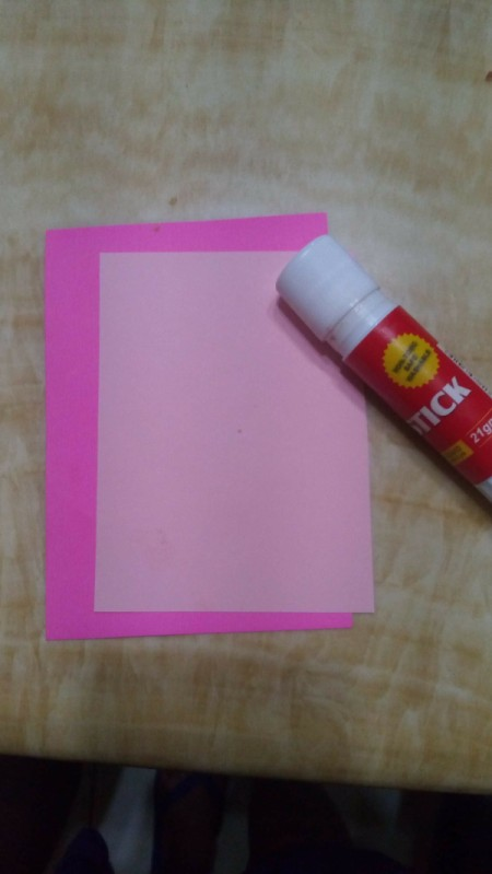 Kissmark Decorative Banner - cut two pieces of paper making the lighter color the smaller piece, glue together
