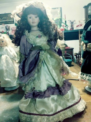 Value of a Porcelain Doll - doll wearing a vintage dress
