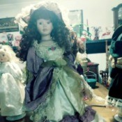 Value of a Porcelain Doll - doll wearing a vintage dress