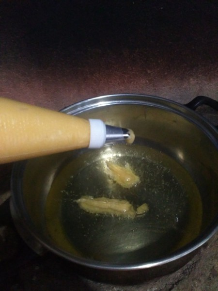 batter dropped in boiling oil
