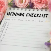 Wedding checklist surrounded by flowers.