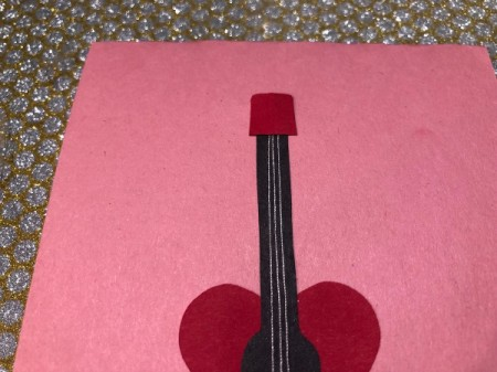 Guitar Heartstrings Card - pull strings taut and glue the head down on the top of the neck