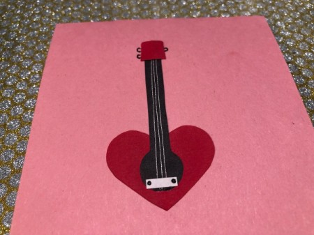 Guitar Heartstrings Card - cut a piece of white paper and glue in place as the bridge, add screws with a pen, draw tuning pegs on the head
