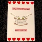 Drum Beat Card - finished card with the message on pink paper add above and below the drum