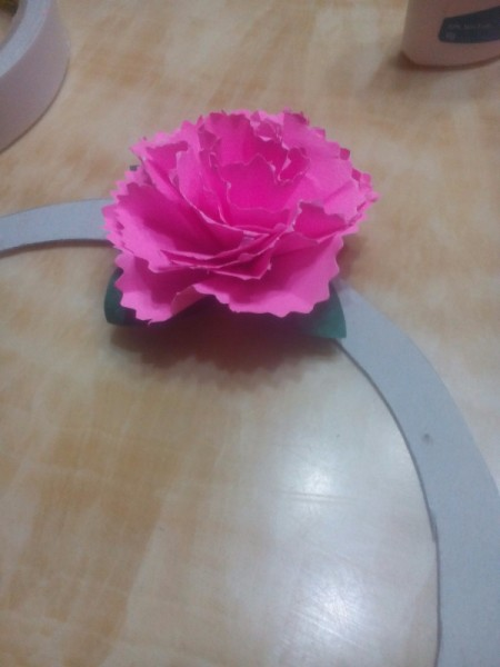 Paper Carnation Wreath - arrange the flowers around the wreath and secure with double sided tape