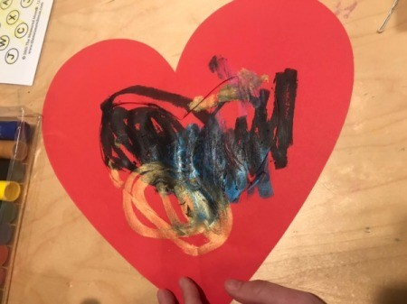 """""""I Love You"""" Toddler Artwork - painting completed, with some color out onto the cut heart"""