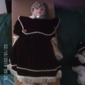 Value of a Karnival Kids Collection Porcelain Doll - doll in black dress with very large collar