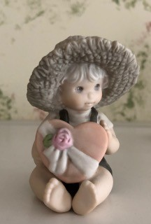 Value of Kim Anderson's Enesco Figurines - child with straw hat holding a pink heart