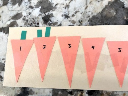 Carrot Counting Activity for Toddlers -  leaves in pockets 1 and 2