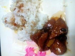 Pork Binaguongan with rice on plate