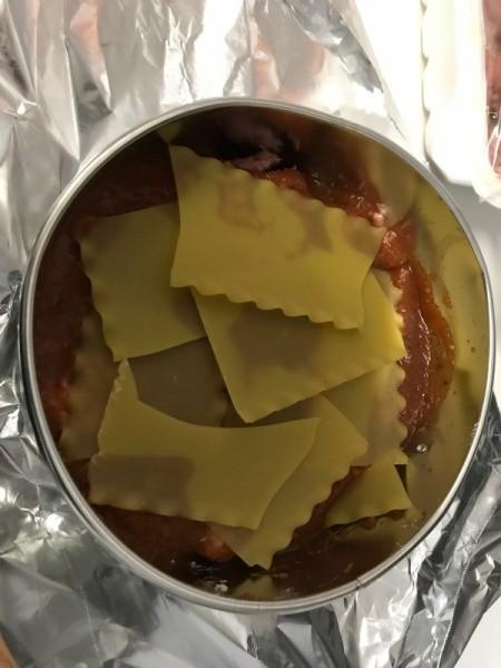 Lasagne noodles on sauce