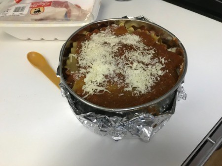 cheese on sauce in pan