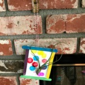 Making a Hanging Air Plant Frame - hanging on a brick fireplace