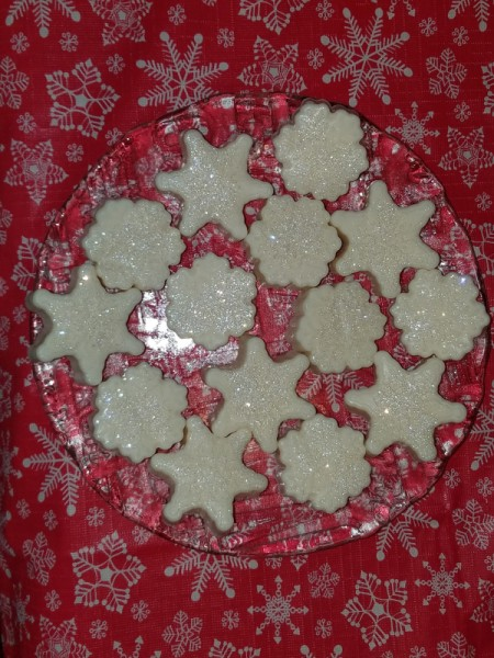 Handmade Bath Products Business Name Ideas - stars and snowflakes on a glass plate on red snowflake background