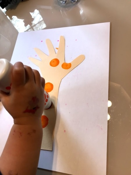 Handprint Giraffe Bookmark - child using a dot marker
