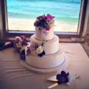 A beautiful cake at an beach wedding.