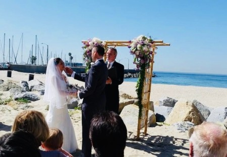 A couple being married on the beach.