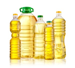 Different sized bottles of cooking oil.