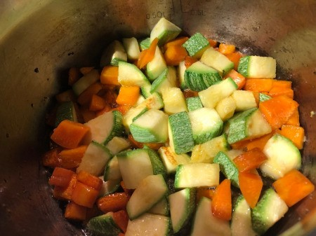 carrots and zucchini added to pot