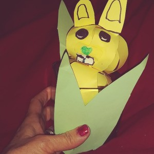 Paper Easter Bunny  - bunny sitting in a votive cup with leaves attached to the candle holder