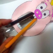 Recycled Animal Face Pencil Case - pencils fit inside the bottle