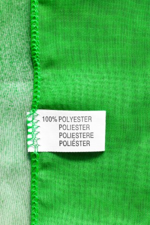 A clothing tag that reads 100% polyester.