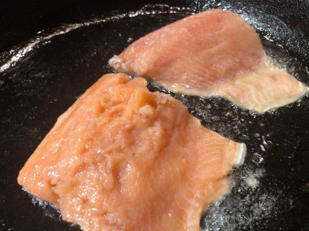 Salmon fillets in pan