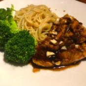 Honey Garlic Salmon with pasta & broccoli on plate