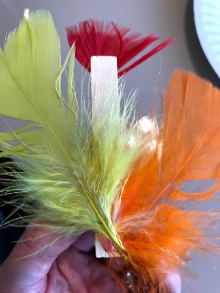 Clothespin Chicken Plant Decoration - two feathers both at angles on back of pin