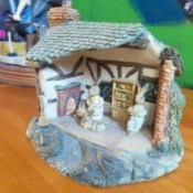 Identifying an Ornament or Figurine - open front cottage with bunny family inside