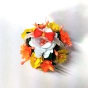 Bottle Cap Mini Flower Basket - top down view of the mini flower basket with a tiny bow on the handle