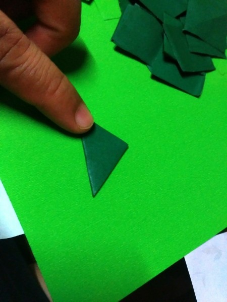 Mini Shamrock Hat Basket  - fold a green paper square in half diagonally to form a triangle
