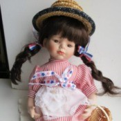 Identifying a Porcelain Cracker Barrel Doll - patriotic doll wearing a straw hat
