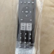 A remote in a plastic bag with bubble wrap on the bottom.