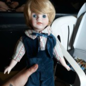 Identifying a Porcelain Doll - doll wearing a blue velvet vest and pants