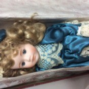 Value of a Dynasty Collection Doll - doll wearing a dark blue satin like dress with lace trim