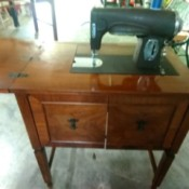 Finding Attachments for a Vintage Kenmore Sewing Machine - machine in a wood cabinet